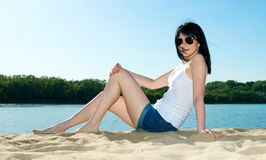 Girl in sunglasses on the beach Royalty Free Stock Photo