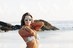 Girl with sunglasses on beach Royalty Free Stock Photos