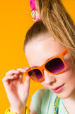 Girl and sunglasses Stock Images