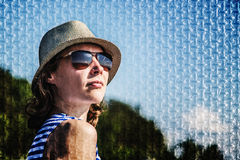 Girl in sunglasses on a blue background. royalty free stock photos