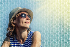 Girl in sunglasses on a blue background. royalty free stock images