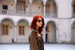 Girl in sunglasses at castle. Photo 1 Royalty Free Stock Photo
