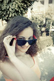 Girl and sunglasses Stock Photography