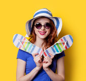 Girl in sunglasses with flip flops Stock Images