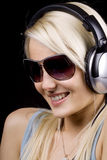 Girl with sunglasses and headphones Stock Photo