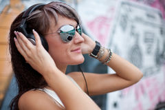 Girl in sunglasses and headphones Stock Photo