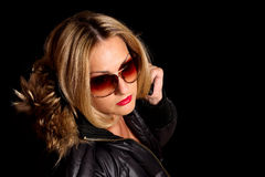 Girl in sunglasses and jacket Royalty Free Stock Photo