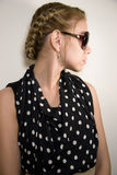 Girl in sunglasses on  light background Royalty Free Stock Images