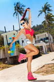 Girl in sunglasses with longboard Royalty Free Stock Photography