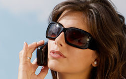 Girl in sunglasses and mobile phone Royalty Free Stock Photo