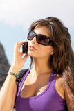 The girl in sunglasses and mobile phone Stock Photos