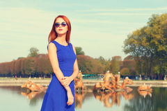 Girl in sunglasses near lake Stock Photo