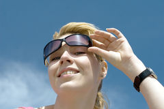 Girl in sunglasses on open air Royalty Free Stock Image
