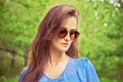 Girl in sunglasses outdoor Stock Image