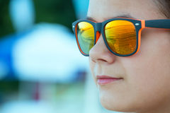 Girl in sunglasses outdoors Royalty Free Stock Photo
