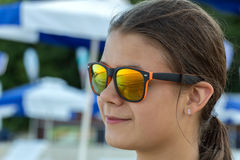 Girl in sunglasses outdoors Royalty Free Stock Images