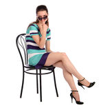 Girl with sunglasses posing on stool. Stock Photography