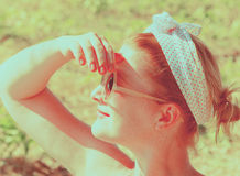 Girl with sunglasses in profile. Portrait beautiful girl wearing sunglasses in an outdoor summer Royalty Free Stock Photo