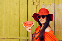 Girl with Sunglasses and  Red Hat with Watermelon Slice Stock Images