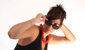 Girl with sunglasses and red necklace Royalty Free Stock Photo