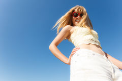 Girl in sunglasses relaxing outdoor against sky Stock Images