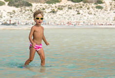Girl in sunglasses at sea Royalty Free Stock Photos