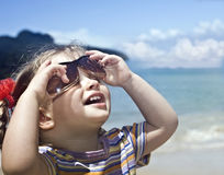 Girl in sunglasses at sea coast. Royalty Free Stock Photo