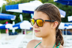 Girl in sunglasses at sea Royalty Free Stock Images