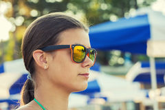 Girl in sunglasses at sea Royalty Free Stock Photo