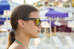 Girl in sunglasses at sea Stock Images