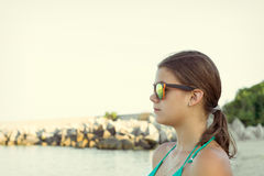 Girl in sunglasses at sea Stock Photos