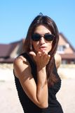 Girl in sunglasses sends air kiss Royalty Free Stock Image