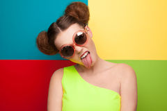 Girl in sunglasses showing tongue Royalty Free Stock Photography