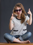 Girl sunglasses smiling pointing Royalty Free Stock Photo