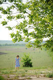 Girl under Tree Stock Image
