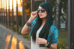 Girl in sunglasses. sun rays sunset Royalty Free Stock Photo