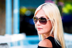 Girl in sunglasses on a sunny summer day. Tanned girl in sunglasses on a sunny, summer, warm day Royalty Free Stock Photo