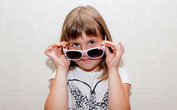Girl  and sunglasses. Teen girl poses with sunglasses Stock Photo