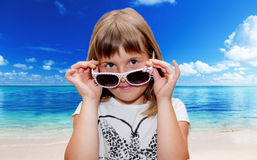 Girl  and sunglasses. Teen girl poses with sunglasses Stock Photos