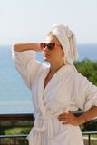 Girl in sunglasses with towel on her head Royalty Free Stock Images