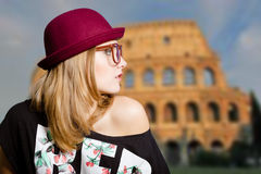 Girl in sunglasses and wreath on Coliseum blurred Stock Image