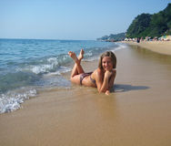 Girl on sunny beach Royalty Free Stock Images
