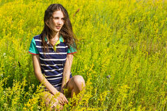 Girl on the sunny field. Royalty Free Stock Photo