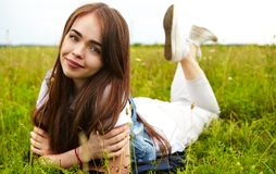 Beautiful girl in a meadow. The girl in the sunny morning in a meadow Stock Photo