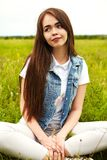 Beautiful girl in a meadow. The girl in the sunny morning in a meadow Stock Photos