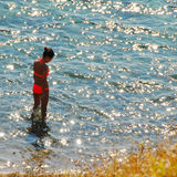 Girl in sunny sea water Royalty Free Stock Photography
