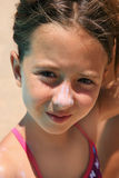 Girl with sunscreen in her nouse Royalty Free Stock Image