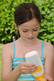 Girl and sunscreen Royalty Free Stock Photos