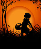 Girl in the sunset 03. Kind of Urban Art Girl with basket in the sunset between black and orange color Stock Photos