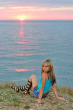 A girl at sunset on the beach Royalty Free Stock Photos
